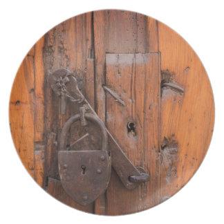 Padlock on wooden door plate