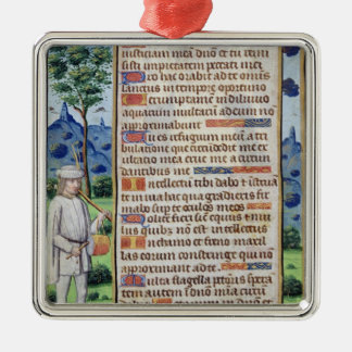 Page of text with a border detail of a christmas ornament