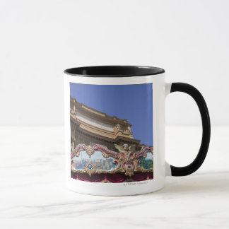 painted decorative carousel with pictures of mug
