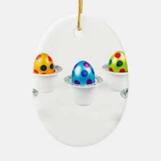 Painted easter eggs standing in porcelain egg cups christmas ornament