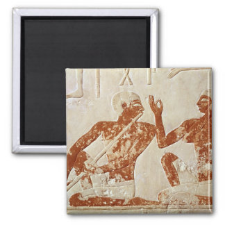 Painted relief depicting a flute player square magnet