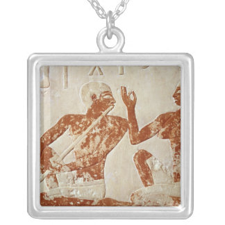 Painted relief depicting a flute player silver plated necklace