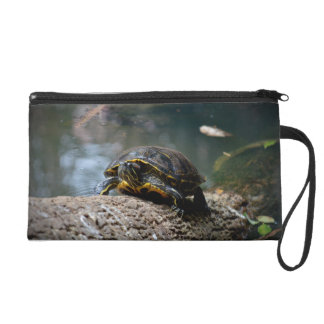 painted water turtle climbing log wristlet clutch