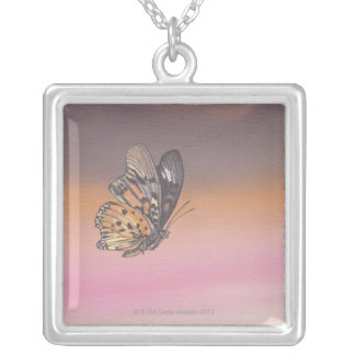 Painting depicting butterfly in flight silver plated necklace