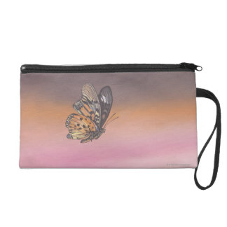 Painting depicting butterfly in flight wristlet