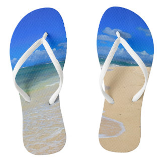 Pair of Flip Flops with Sand and Surf Picture