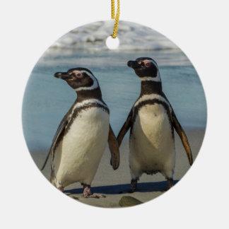Pair of penguins on the beach round ceramic decoration