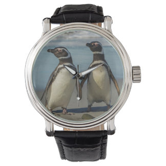 Pair of penguins on the beach wristwatch