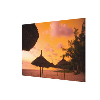 Palapa style beach huts at sunrise, Belle Mare 2 Canvas Print