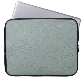 Pale green embossed-look geometric harlequin laptop sleeve