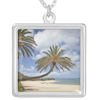 Palm tree leaning out over the sand at Sunset Silver Plated Necklace