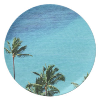 Palm trees and surface of the sea plate