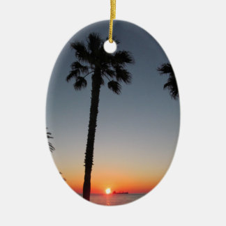 Palm trees at sunset ceramic oval decoration