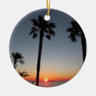 Palm trees at sunset round ceramic decoration
