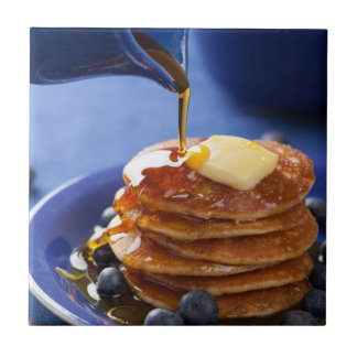 Pancakes with syrup and blueberry small square tile