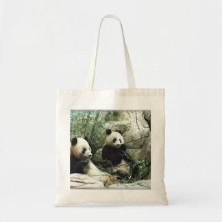 Panda bear eating and playing tote bag