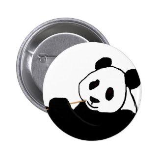 Panda bear eating button
