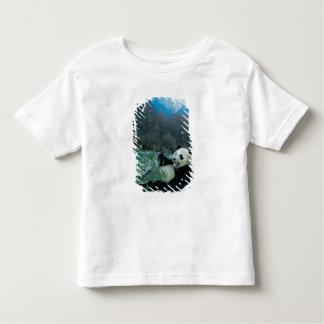 Panda eating bamboo by river bank, Wolong, 2 Toddler T-Shirt