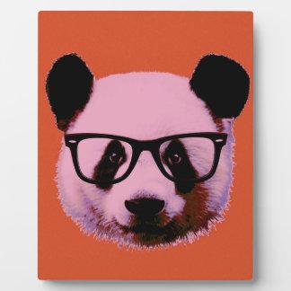 Panda with glasses in orange plaque