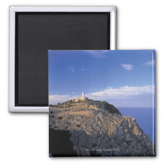 panoramic view of a light house on a cliff magnet