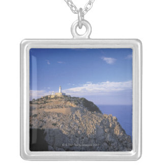 panoramic view of a light house on a cliff silver plated necklace