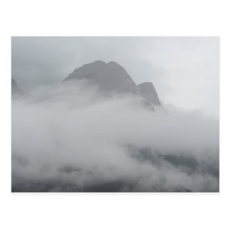 Panoramic view of mountains in the fog postcard