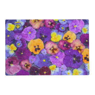 Pansy flowers floating in bird bath with dew laminated placemat
