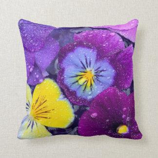 Pansy flowers floating in bird bath with dew throw cushion