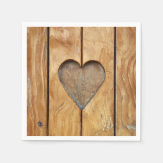 Paper napkin with one heart in vintage wood