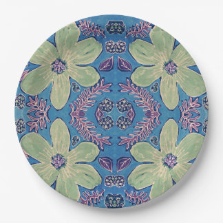 Paper plate with green flowers on blue background