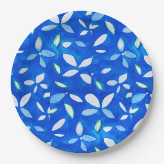 Paper plates with flowers on blue background