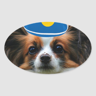 Papillon Puppy Dressed as a Clown Oval Sticker