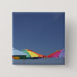 Parasols at the beach. Sun-umbrellas. 15 Cm Square Badge