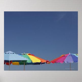 Parasols at the beach. Sun-umbrellas. Poster