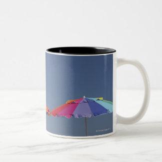 Parasols at the beach. Sun-umbrellas. Two-Tone Coffee Mug