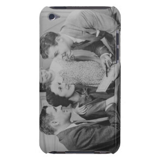Parents and daughter (6-7) talking with male Case-Mate iPod touch case