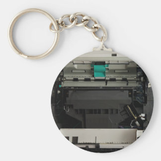 Part of the electronic interior of a laser printer basic round button key ring