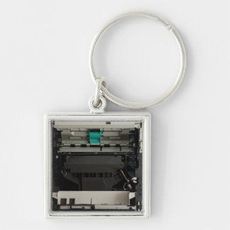 Part of the electronic interior of a laser printer Silver-Colored square key ring
