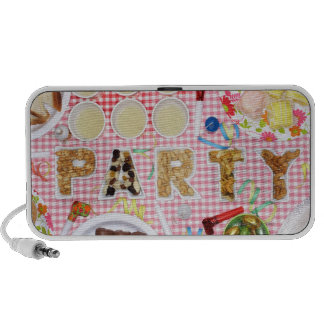 Party food on table in dishes spelling 'PARTY', Travelling Speaker