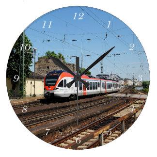 Passenger train in coarse home on the Rhine Large Clock