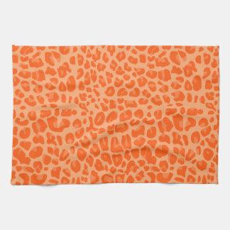 Pastel orange leopard print pattern tea towel