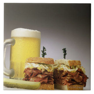 Pastrami on rue with beer large square tile