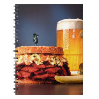 Pastrami sandwich with mug of beer notebooks
