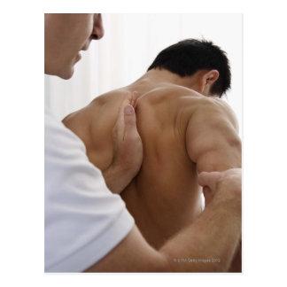 Patient receiving osteopathic treatment postcard