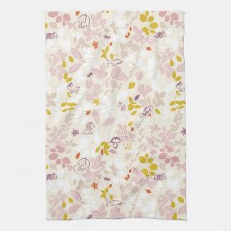 pattern displaying whimsical animals tea towel