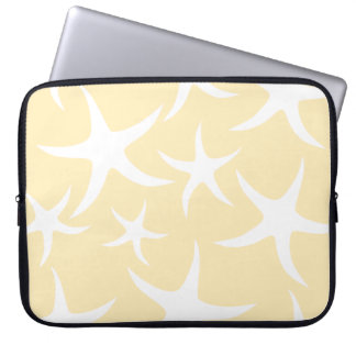 Pattern of Starfish in White and Yellow. Laptop Sleeves