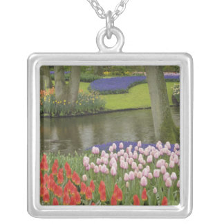 Pattern of tulips and grape hyacinth flowers, silver plated necklace