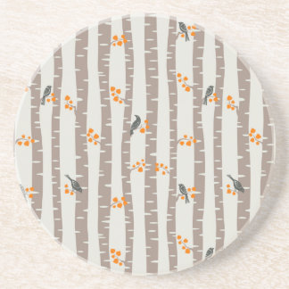 Pattern with autumn trees and birds drink coaster