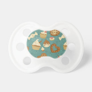 Pattern with cupcakes and candies baby pacifiers