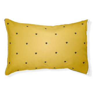 Paw print pattern on pre-faded gold background. pet bed